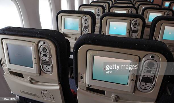 The seat of the economy class can be seen onboard the new Airbus A380 superjumbo passenger jet as it parks on the tarmac of the Airbus plant in...