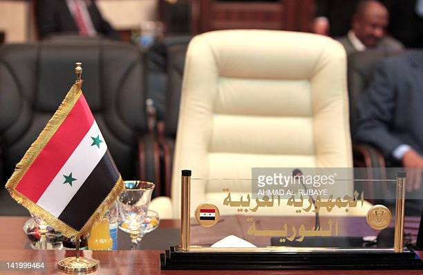 The seat of the Syrian representative remains empty as other delegates arrive to attend a meeting of Arab foreign ministers in the framework of the...