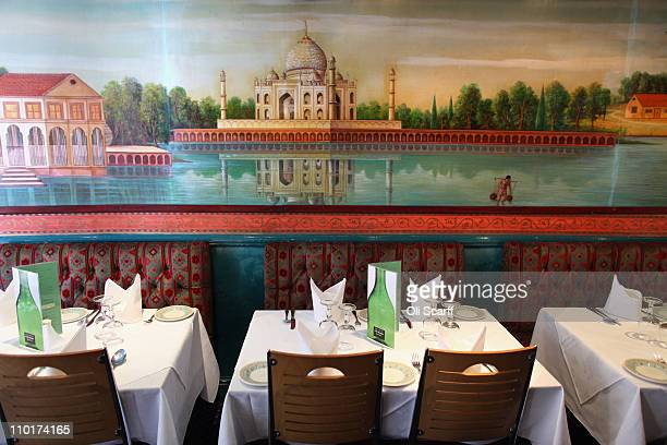 The seating area of Cafe Bangla curry house on Brick Lane on March 16 2011 in London England From April 2011 the Government has ruled that only...