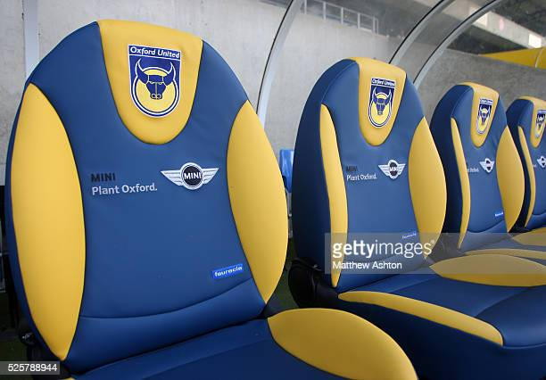 The seats in the bench bearing the crest of Oxford United sponsored by Mini