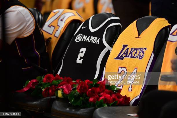 The seats where NBA legend Kobe Bryant and his daughter Gianna Bryant sat on the last game they attended at the Staples Center are pictured covered...