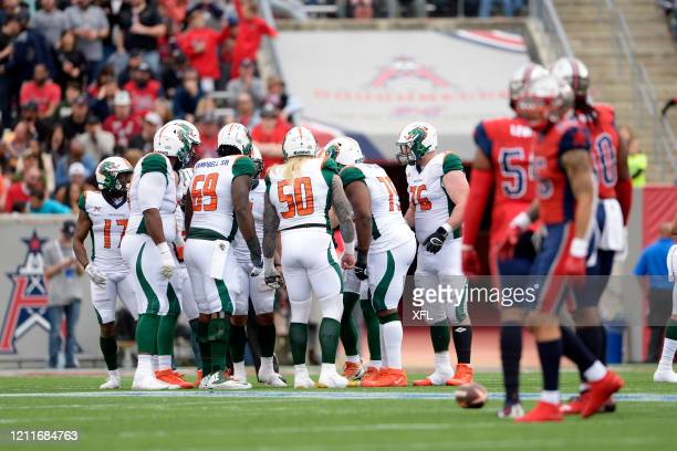 The Seattle Dragons huddle during the XFL game against the Houston Roughnecks at TDECU Stadium on March 7, 2020 in Houston, Texas.