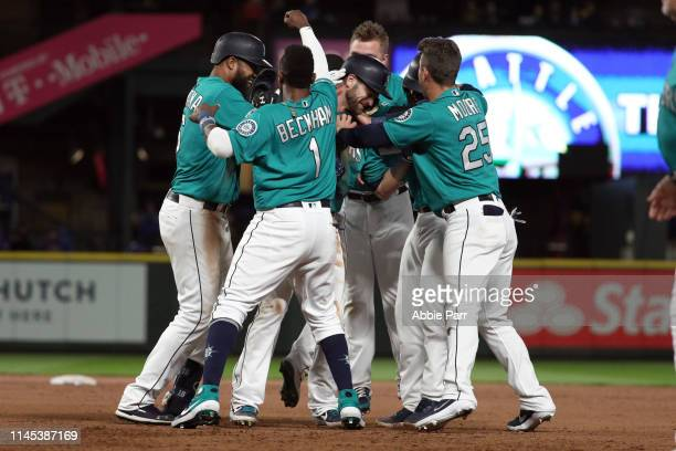 The Seattle Mariners celebrate after defeating the Texas Rangers 54 from a groundout by Mitch Haniger of the Seattle Mariners to score Omar Narvaez...