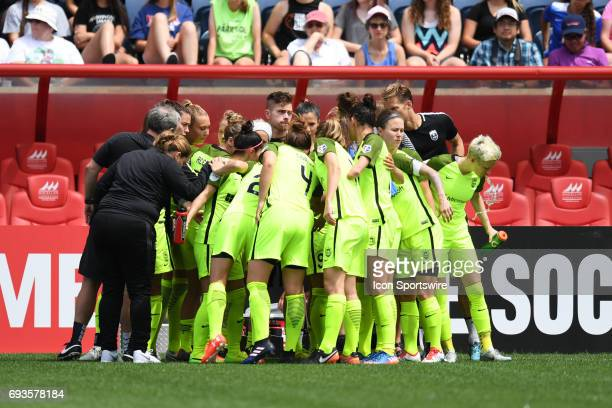 The Seattle Reign FC huddle prior to the first half during a game between the Seattle Reign and the Chicago Red Stars on June 4 at Toyota Park in...