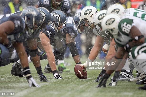 The Seattle Seahawks defense lines up against the New York Jets offensive line on December 21 2008 at Qwest Field in Seattle Washington The Seahawks...