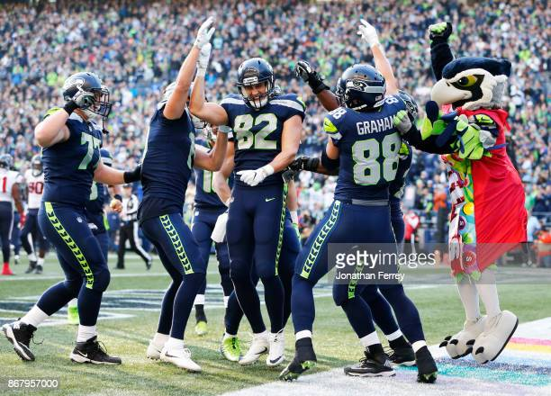 The Seattle Seahawks including Luke Willson and mascot Blitz celebrate a 1 yard touchdown by tight end Jimmy Graham during the fourth quarter of the...