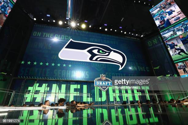 The Seattle Seahawks logo is seen on a video board during the first round of the 2018 NFL Draft at ATT Stadium on April 26 2018 in Arlington Texas