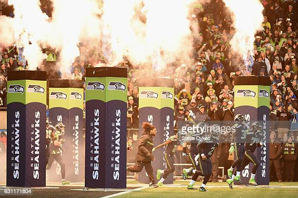 The Seattle Seahawks run onto the field prior to the NFC Wild Card game against the Detroit Lions at CenturyLink Field on January 7 2017 in Seattle...