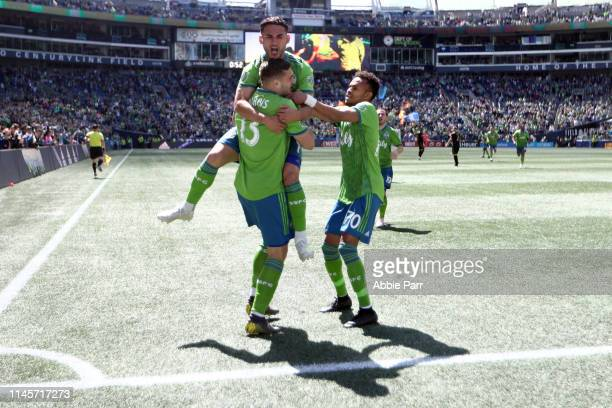 The Seattle Sounders celebrate a goal by Jordan Morris of Seattle Sounders in the first minute of play against the Los Angeles FC during their game...