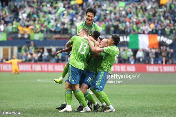 The Seattle Sounders celebrate a goal by Kelvin Leerdam of the Seattle Sounders to take a 10 lead against Toronto FC in the second half during the...