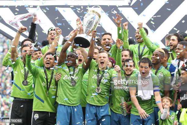 The Seattle Sounders celebrate after defeating Toronto FC 31 to win the 2019 MLS Cup at CenturyLink Field on November 10 2019 in Seattle Washington