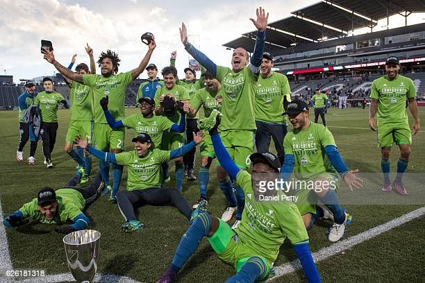 The Seattle Sounders celebrate after winning the MLS Western Conference trophy over the Colorado Rapids during the second leg of the Western...