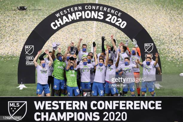 The Seattle Sounders celebrate their 3-2 win against Minnesota United during their Western Conference Finals game at Lumen Field on December 07, 2020...