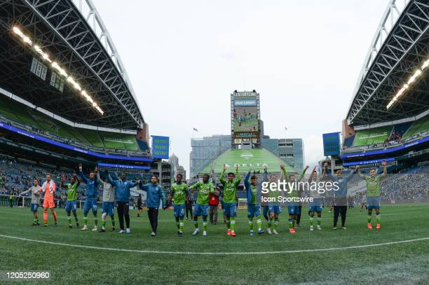 The Seattle Sounders celebrate with Seattle fans after a MLS match between the Chicago Fire and the Seattle Sounders at Century Link Field in Seattle...