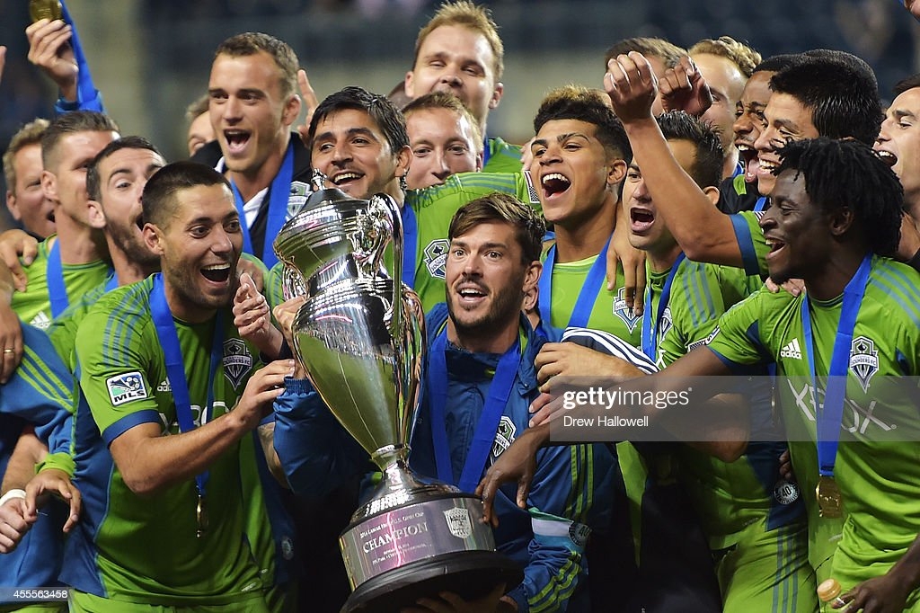 The Seattle Sounders FC celebrate their 3-1 win over the Philadelphia Union for the 2014 U.S. Open Cup Final at PPL Park on September 16, 2014 in Chester, Pennsylvania.