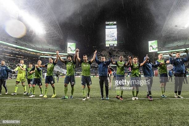 The Seattle Sounders line up in front of the goal to celebrate with fans after beating the Colorado Rapids in the rain at CenturyLink Field on...