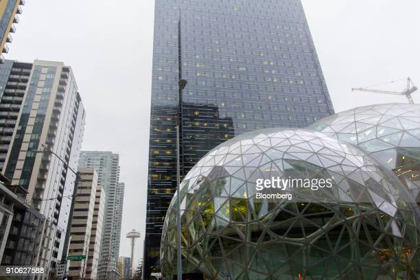 The Seattle Space Needle is seen past the Amazoncom Inc Spheres in Seattle Washington US on Tuesday Jan 23 2018 The online retailer is scheduled to...
