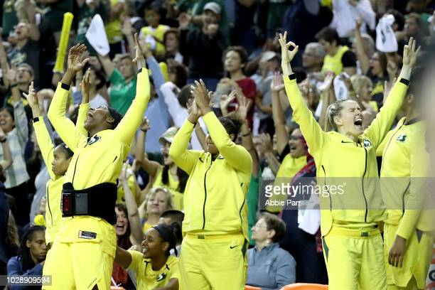 The Seattle Storm bench celebrates in the third quarter against the Washington Mystics during game one of the WNBA Finals at KeyArena on September 7...