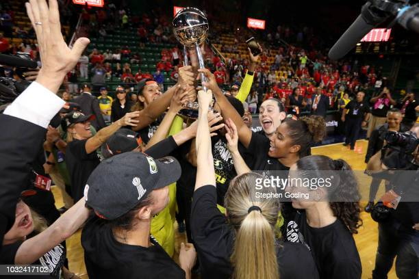 The Seattle Storm celebrate the win against the Washington Mystics during Game Three of the 2018 WNBA Finals on September 12 2018 at the EagleBank...