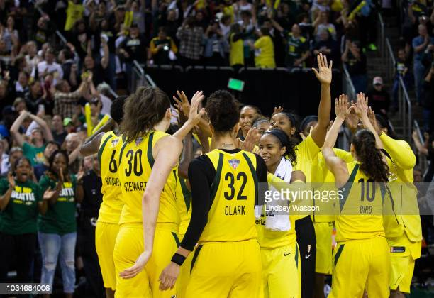 The Seattle Storm celebrate their close win over the Washington Mystics in Game 2 of the WNBA Finals at KeyArena on September 9 2018 in Seattle...