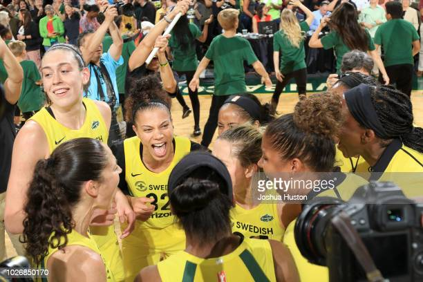 The Seattle Storm celebrates after the game against the Phoenix Mercury during Game Five of the 2018 WNBA Playoffs on September 4 2018 at Key Arena...