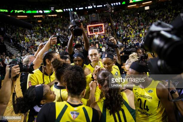 The Seattle Storm huddle after beating the Washington Mystics in Game 2 of the WNBA Finals at KeyArena on September 9 2018 in Seattle Washington The...