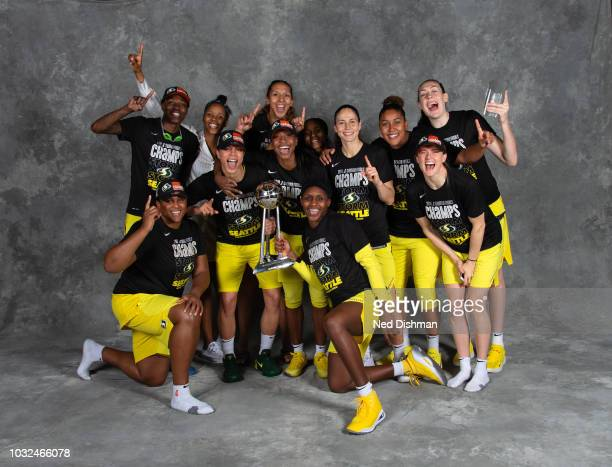 The Seattle Storm poses with the 2018 WNBA Championship trophy after defeating the Washington Mystics in Game Three of the 2018 WNBA Finals on...