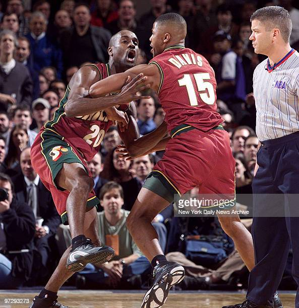 The Seattle Supersonics' Gary Payton charges angrily towards referee Ted Bernhardt after being called for a technical foul during first quarter of...