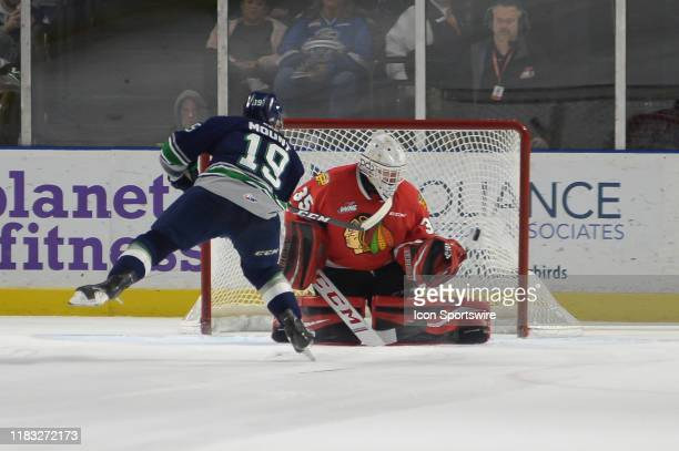 The Seattle Thunderbirds rightwing Payton Mount put a shot in the goal during a shootout near the end of an WHL game between the Seattle Thunderbirds...
