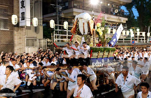 The second float 'HigashiNagare' rushes through Seido Street of Kushida Jinja Shrine during the Hakata Gion Yamakasa festival on July 15 2015 in...