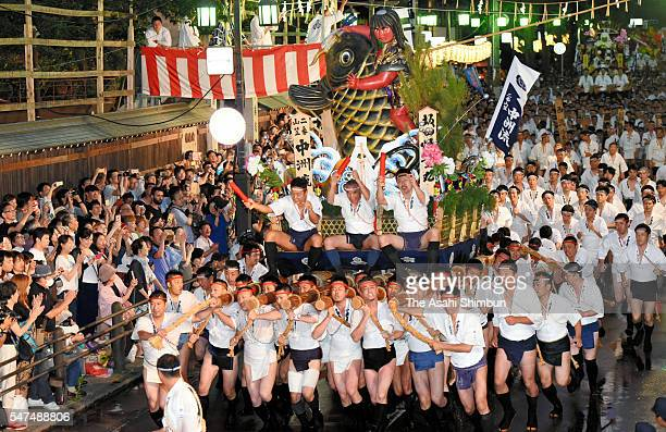 The second float 'Nakasu Nagare' rushes through Seido Street of Kushida Jinja Shrine during the Hakata Gion Yamakasa festival on July 15 2016 in...