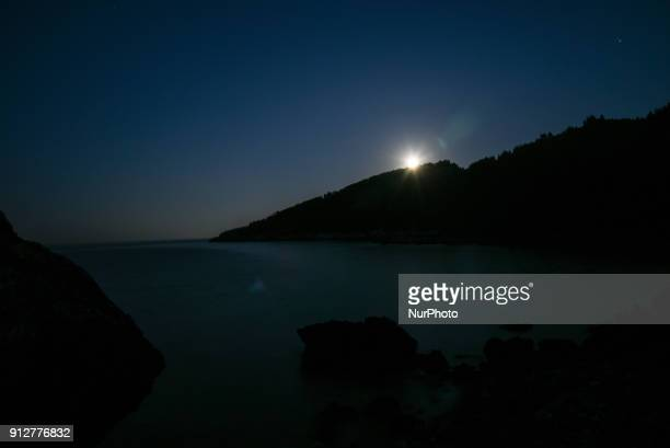 The second full moon of January 2018 the blue moon arising over the Aegean sea in Pilio on Euboea on January 31 2018