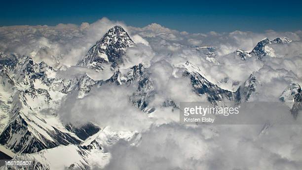 The second highest mountain in the world with a peak elevation of 8,611 m , is viewed from a Boeing 737 aircraft during an air safari.