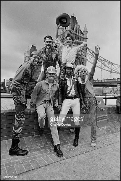 The second lineup of American disco group Village People with lead singer Ray Simpson pose by Tower Bridge London 28th July 1980