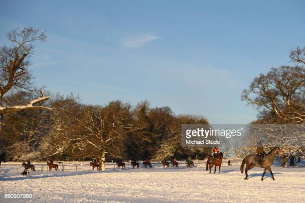 The second lot head back towards the stables after morning gallops in heavy snow at the yard of national hunt trainer Nigel TwistonDavies on December...