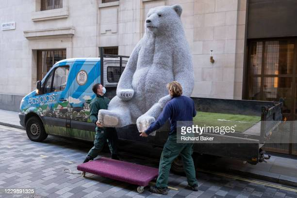 The second of two giant Christmas decoration bears are offloaded from a sub-contractor's lorry and delivered to the foyer of the Cafe Royal in Air...