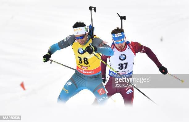 TOPSHOT The second placed Martin Fourcade of France and Anton Shipulin of Russia compete during the men's 10 km sprint event at the IBU World Cup...