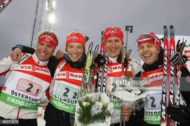 The second placed Norwegian Relay Team Emil Hegle Svendsen Alexander Os Lars Berger and Ole Einar Bjoerndalen pose after the Men's 4x75 km Relay in...