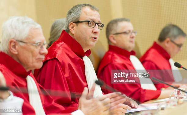 The second senate of the Federal Constitutional Court of Germany with Michael Gerhardt chairman Andreas Vosskuhle Peter Huber and Peter Mueller sit...