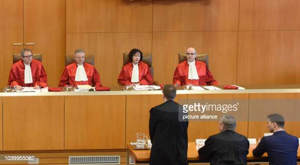The second senate of the German Constitutional Court take their seats before hte announcement of the verdict on the NPD ban proceedings at the German...