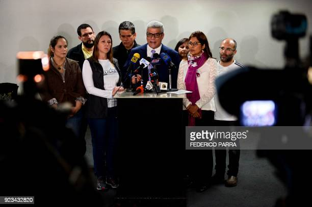 The second vice president of Venezuela's National Assembly Alfonso Marquina accompanied by opposition deputies of the Primero Justicia party offers a...