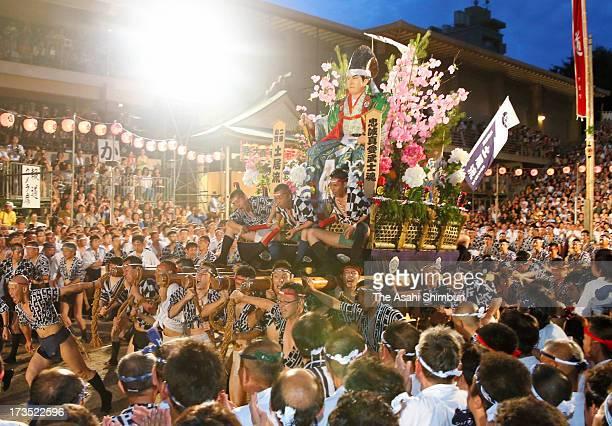 The second 'Yamakasa ' race through Seido Street of Kushidajinja Shrine during the Hakata Gion Yamakasa festival on July 15 2013 in Fukuoka Japan The...