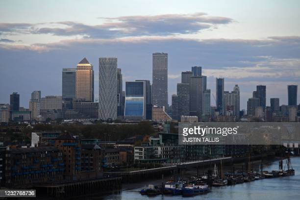 The secondary central business district of Canary Wharf is pictured as the sun sets in London on Saturday, May 8 where Labour mayor Sadiq Khan was...