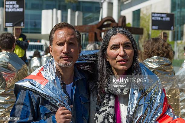 The Secretary General of Amnesty International in Germany Selmin Caliskan and the actor Benno F��hrmann call during a campaign by Amnesty...