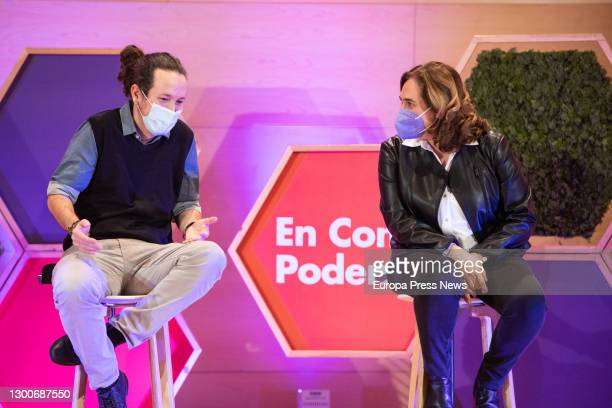 The secretary general of Podemos and second vice president of the Government, Pablo Iglesias, speaks with the Mayor of Barcelona, Ada Colau, during...