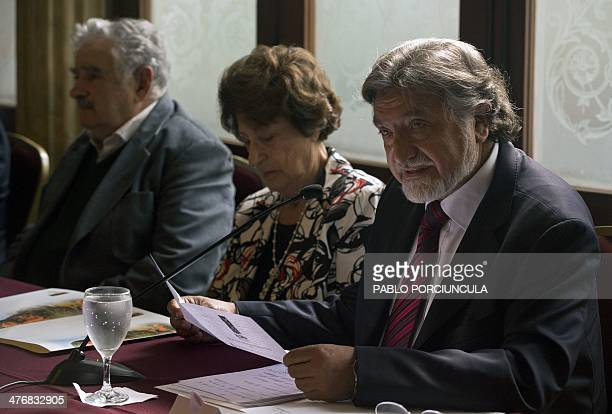 The Secretary General of the Latin American Association of Human Rights Chilean Juan de Dios Parra speaks nex to Uruguay's President Jose Mujica and...