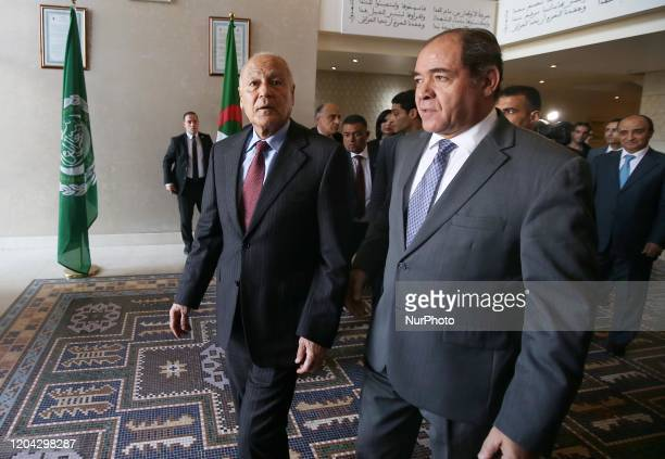 The secretary general of the League, Ahmed Aboul Gheit , walks with the Algerian Minister of Foreign Affairs Sabri Boukadoum as they meet at the...