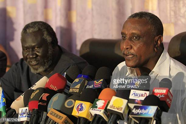 The secretary general of the northern branch of the exrebel Sudan People's Liberation Movement Yasser Arman and Malik Agar the party's chairman hold...