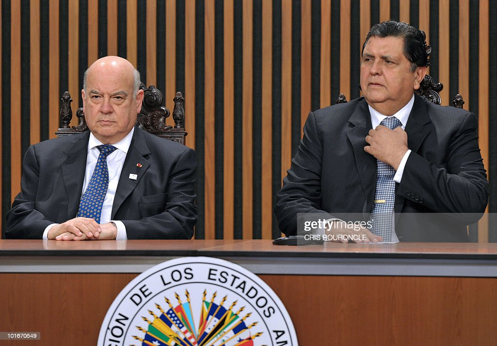 The Secretary General of the Organization of American States (OAS) Jose Miguel Insulza (L) sits next to Peruvian President Alan Garcia, after delivering the opening speech during the inauguration of the 40th OAS General Assembly held at the National Museum in Lima, Peru on June 6, 2010. Ministers and representatives of the 33 member countries will meet for three days under the topic 'Peace, Security and Cooperation of the Americas'.