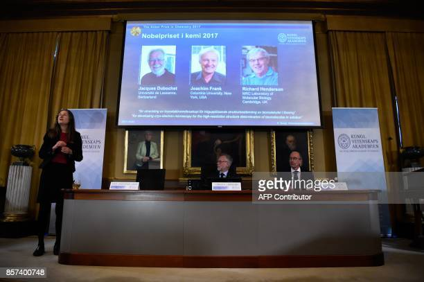 The Secretary General of the Royal Swedish Academy of Sciences Goran Hansson and Peter Brezezinski member of the Nobel Committee for Chemistry listen...
